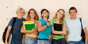 Group of students holding books summer language class