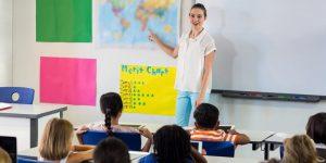 Young Female teacher teaching salish language in elementary class